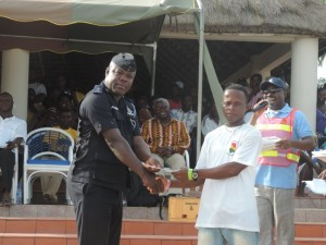 Winner receiving prize from Marine Police