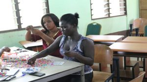 Rita Amoah having her hands on the beads making 1JPG