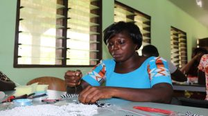 Beneficiaries practising on the beads making# 3 1JPG